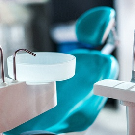 a dental treatment room with dental tools sitting next to a chair