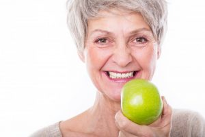 woman smiling apple