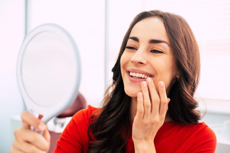 girl admiring dental implants